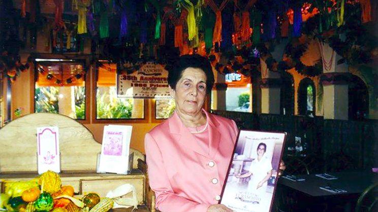 Mama holding menu in Huntington Park